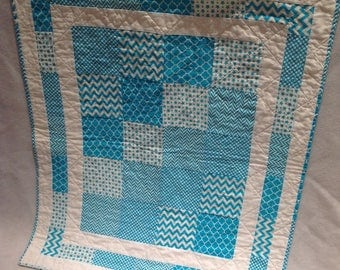 Turquoise and white baby quilt