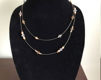 A double-strand illusion necklace (gold and clear colors)