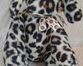 Plush leopard print dog.  Adorable!