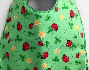 Ladybugs, Clovers, and Flowers Baby Bib