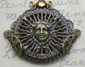 Super rare Sun Child French brass pendant for you to finish with beautiful beads..