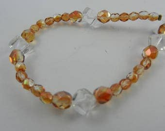 mixed 6-8mm half coated topaz and crystal abt 4-10mm crystal beads total strand 27 beads 80028