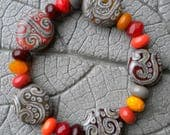 Warm Tone SCROLL Tabs Spacers Lampwork Bead by Cherie Sra R114 Flameworked Focal Glass Tab Orange Brown Silvered Ivory Stringer Scroll Bead