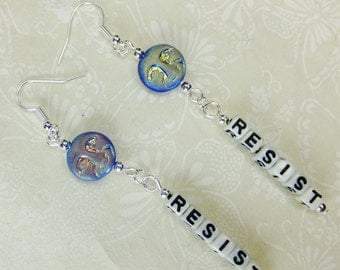 Blue Moon Face Bead RESIST Verticle Dangle Earrings Handcrafted with Black and White Acrylic Letter Beads and Blue Moon Face Glass Beads