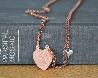 Hand engraved anatomical heart diagram on long copper necklace