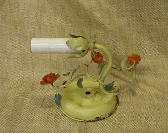 Metal wall sconce light fixture with flowers