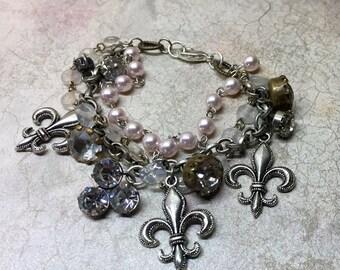 Vintage Fleur de Lis charm bracelet with vintage rhinestones, rosary bead and pink pearls