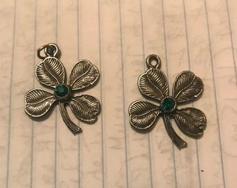 "Pewter Shamrock Charms, 1"" wide, with green jewel in center"