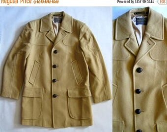 MOVING 4 GRADSCHOOL SALE Vintage Pendleton camel wool coat, fully lined, with many pockets, notched collar, and leather woven buttons, mediu