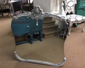 Shaped Mirror with Ornate Carved Trim