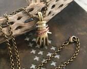 Brass Hand Pendant