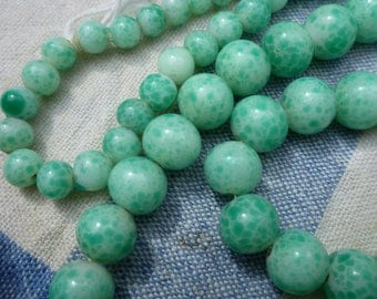 Peking Glass necklace, looks like jade, art deco and lovely with summer linens.