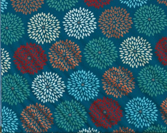 A marsala moment flower burst in blue with metallic copper accents from Jack!e