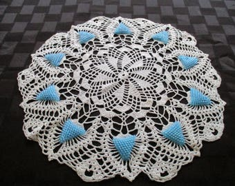Crocheted white doily with turquoise  beads