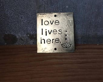 love lives here - blackened brass passages plaque
