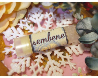sembene - cinnamon dusted chocolate lip embellishment - housed in nifty frosted dispenser