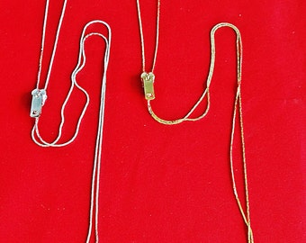"""Vintage gold or silver tone lariat style necklace,  28"""" with zipper pull styling in unworn condition, New Old Stock"""