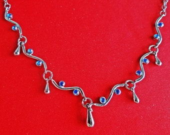"Vintage  15"" silver  tone necklace with blue rhinestones in great condition, appears unworn"