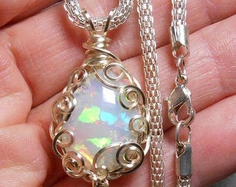 Large Ethiopian crystal opal pendant, misty white base color, very bright multicolor fire, hand wrapped silver parawire setting