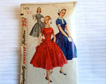 Vintage 1950 Day or Party Dress sewing pattern.   Simplicity.   Teen Size 14.   Bust size 32.  No. 1474.