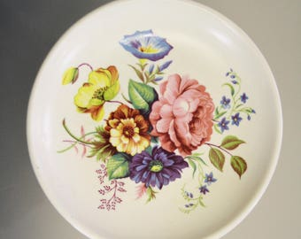 Floral patterned plate by Poole Guild crafts, vintage pottery