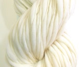 100 yards and 7.1 ounces/ 203 grams hand spun yarn, super bulky, in thick and thin natural cream merino wool