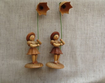 Vintage springtime flower holding wood wood composite girl figurines.  Lot of 8 figurine.