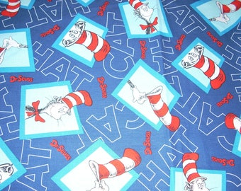 Cat In The Hat , Dr. Seuss - on blue Cotton Fabric - 15 1/2inches wide and sold by the yard