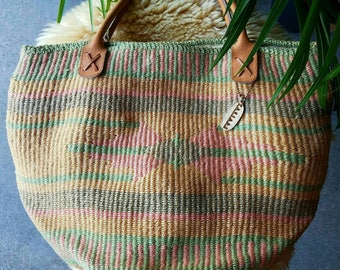 vintage 90s 1990s oversized woven jute tote shoulder bag leather strap handle muted pastel southwestern beach Ceasars boho festival