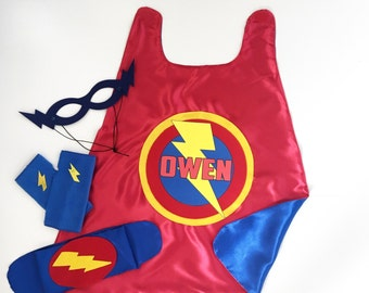 Fast Shipping - Boys Personalized 4 piece SUPERHERO CAPE SET-Includes personalized cape with child's name, hero belt, mask, and arm bands