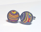 Cuff links with fordite motor agate cabochon