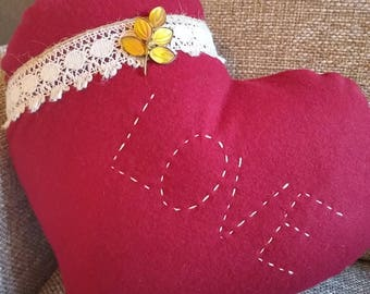 Decorative heart pillow from vintage red wool
