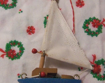 little wooden sailboat ornament
