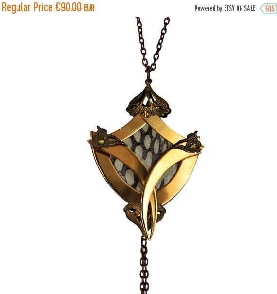 GRAND SALE / 50 % OFF / Wadjet / Gold Coat of Arms Cage Cobra Skin Medallion / Free Shipping