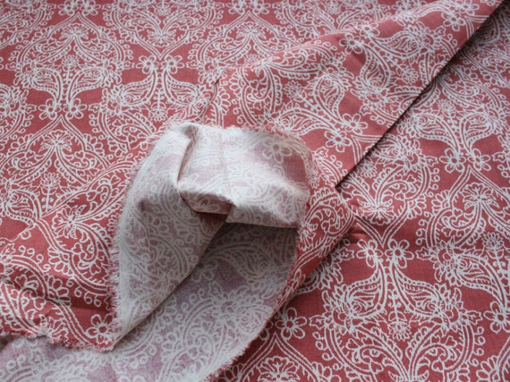 Coral color Cotton print fabric Folklore pattern of Joann