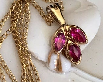 Jewelmont vintage 14 kt gold filled necklace with 3 ruby stone pendant .