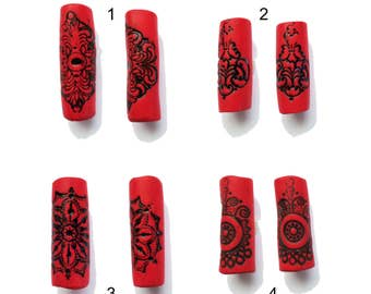 Red with black mandala dreadlock bead.