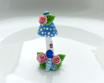 Miniature fairy mushroom house in blue handmade from polymer clay