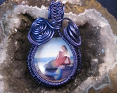 Wire wrapped pendant with pin up mermaid cabachon