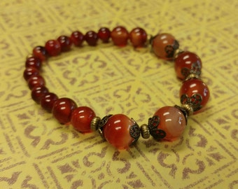 Red Agate Gemstone Stretch Bracelet With Gold-Plated Brass Accents