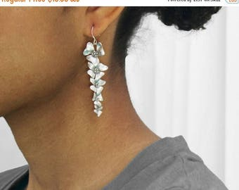 20% off. Hibiscus flower cascade earrings in silver . five silver flowers for your valentine