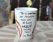 "J.K. Rowling ""It is important to remember that we all have magic inside us"" Hand painted, medium white mug with gold magic trails"