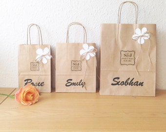 Wedding favour bag MEDIUM personalised brown paper gift bag  (18cm x 22cm x 8cm) with Flower and cut out guest name
