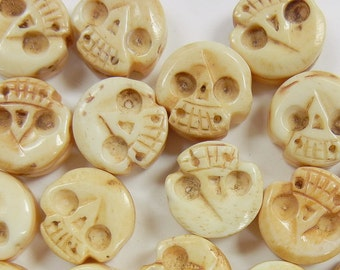 17x16x7mm hand carved skull, two sided, bone beads, two piece lot,  (CBB-23)