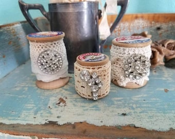 Upcycled wooden spools with vintage lace and rhinestone pieces