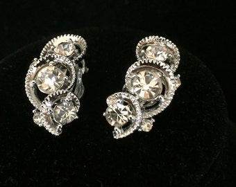 Vintage silver toned Clip Earrings With Three Rhinestones