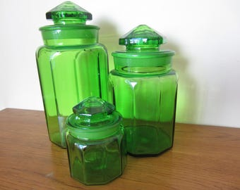 Vintage set of three heavy green glass canisters.  Kitchen organization.