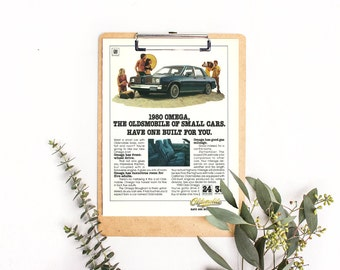 Oldsmobile Omega • 1980s Car Advertisement • Campy 80s Photo Garage Shop Picture • Vintage Car Ad • Beach With Car • Have One Built For You