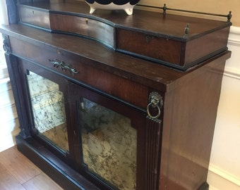 Vintage wooden buffet with lion details. Smoky glass. Atlanta interior design