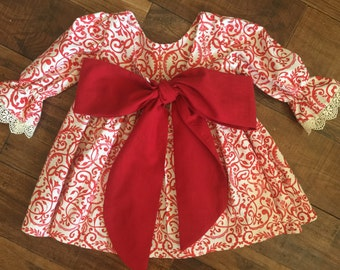 Ella dress - bow back baby girl's dress with bell sleeves and large red bow on back.